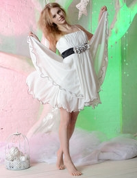 Blonde cutie in a white dress looking like an angel flashes and later starts to dance during a strip show.